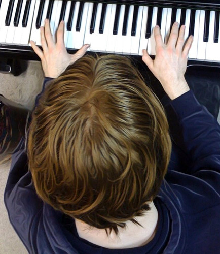 kid plays piano
